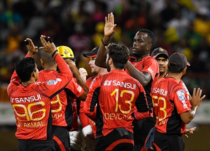 Trinbago Knight Riders celebrate another wicket en route to victory over Guyana Amazon Warriors on Sunday night. (Photo coutesy CPL)