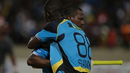 24 July 2016; Daren Sammy congratulates Johnson Charles on his match winning knock of 94 during Match 23 of the Hero Caribbean Premier League match between St Lucia Zouks and Guyana Amazon Warriors at the Daren Sammy Cricket Stadium in Gros Islet, St Lucia. Photo by Ashley Allen/Sportsfile