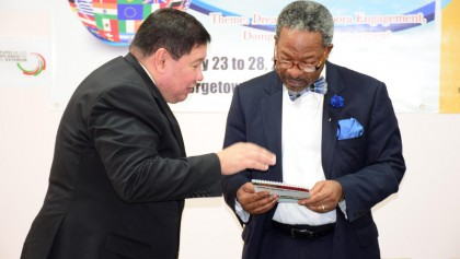 Vice Chancellor of the University of Guyana Professor Dr Ivelaw Griffith (L)  and Mexican Ambassador Ivan Robero Sierra Medel