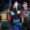BASSETERRE, SAINT KITTS AND NEVIS - AUGUST 21: In this handout image provided by CPL T20, Tabriaz Shamsi (L) and Ben Hilfenhaus (R) of St Kitts and Nevis Patriots celebrate a wicket during Match 20 of the 2017 Hero Caribbean Premier League between St Kitts and Nevis v Jamaica Tallawahs at Warner Park on August 21, 2017 in Basseterre, St Kitts. (Photo by Ashley Allen - CPL T20 via Getty Images)