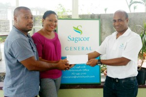 Dominican homeowners Daryl and Anna Lewis are insured with Sagicor General and were among those receiving cash settlements from Sagicor General's Assistant Vice-President of Claims, John Chandler .