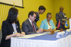 Monica La Bennett, signs the MOU between CDB and EXIM Bank of China